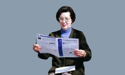 Woman reading newsletter